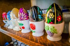 French porcelain eggcups. French porcelain painted eggcups with painted eggs on top Stock Image