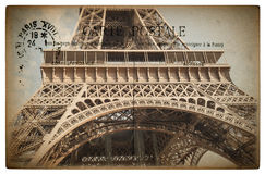 French postcard from Paris with landmark Eiffel Tower. Vintage sentimental retro style paper background Stock Image