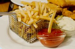 French potatoes in chip fryer Royalty Free Stock Photography