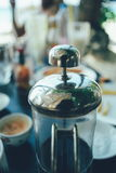 French press coffee maker in a cafe bar. close up image toned image selective focus.  Stock Image