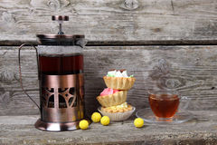 French-press, cup of tea and cakes royalty free stock photo