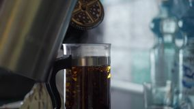 French press with hot tea. In light slowmotion. Beautiful tea leafs in glass teapot stock video