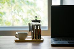 French press with laptop royalty free stock photography
