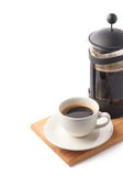 French press pot and cup of coffee Royalty Free Stock Photos