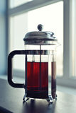 French press on sofa. In living room closeup Royalty Free Stock Photography