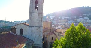 French Provence town GRASSE CATHEDRAL, View of Old French Town. NOTRE-DAME DU PUY CATHEDRAL, Old Bells Ringing In A Church Tower in typical Provence town GRASSE stock footage
