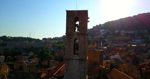 French Provence town GRASSE CATHEDRAL, View of Old French Town. NOTRE-DAME DU PUY CATHEDRAL, Old Bells Ringing In A Church Tower in typical Provence town GRASSE stock video