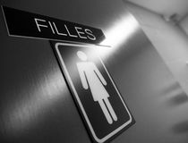 French public women`s washroom sign. French women`s bathroom sign in black and white. Blurred background royalty free stock images