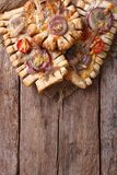 French puff cakes with red onions  vertical top view Royalty Free Stock Photos