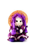 French purple lavender doll. A purple doll from France. Its colour is the same of lavender. White background Stock Image