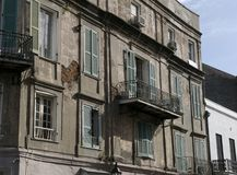 French Quarter Architecture. Walls and balconies show their age, and sometimes live ferns, in the French Quarter of New Orleans, Louisiana Stock Photography