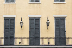 French Quarter Balcony with Doors and Lamps. Balcony of a French Quarter New Orleans, Louisiana apartment, with doors and gas lamps Stock Image