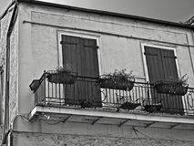 French Quarter Building with Two Doors and Balcony with Three Planters. New Orleans, LA USA - May 9, 2018 - French Quarter Building with Two Doors and Balcony stock image