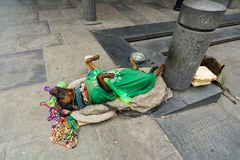 French Quarter Dog. New Orleans, LA USA - April 20, 2016: A dog street performer playing dead in the historic French Quarter district royalty free stock photo