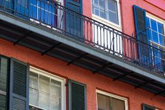 French Quarter New Orleans Balcony. Colorful balconies line the streets in the French Quarter of New Orleans Louisiana. Close-up view of red building with stock photos