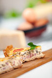 French Quiche Lorraine. A slice french quiche lorraine with bacon , mushrooms and cheese. Shallow depth of field on quiche slice Stock Images