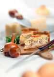 French Quiche Lorraine. A slice french quiche lorraine with bacon , mushrooms and cheese. Shallow depth of field on quiche slice Royalty Free Stock Photos