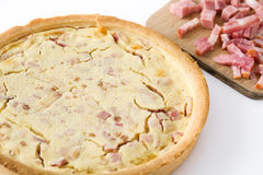 French quiche Lorraine with bacon and cooked ham isolated Royalty Free Stock Images