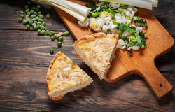 French Quiche Lorraine with ingredients on wood board Royalty Free Stock Photo