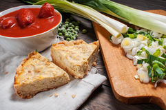 French Quiche Lorraine with ingredients on wood board Stock Photography