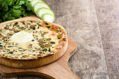 French quiche Lorraine with vegetables on a rustic wooden table Stock Photo