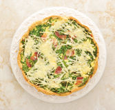 French quiche pie with egg, cheese and spinach Stock Photos
