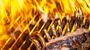French Rack of Lamb on Grill with Flames Stock Photo