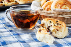French raisin buns and cup of tea Royalty Free Stock Image