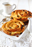 French raisin buns. And cup of tea Royalty Free Stock Image