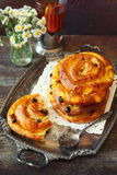 French raisin buns and cup of tea. Toned image Royalty Free Stock Photos
