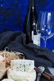 French red wine and soft cheeses on black stone platter royalty free stock image