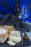 French red wine and soft cheeses on black stone platter stock photography