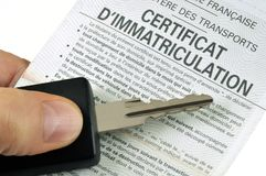 French registration certificate with a car key stock image