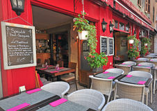 French restaurant, Annecy. ANNECY, FRANCE - AUGUST 22, 2015: Typical savoyard restaurant in city centre of Annecy on August 22, 2015. Annecy is a capital of Stock Image