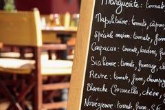 French restaurant Paris france menu board closeup. French restaurant in Paris france with menu board Royalty Free Stock Image