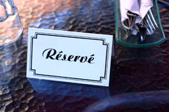 French restaurant reserved table sign card place reservation Royalty Free Stock Images