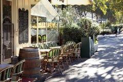 French restaurant scene, Paris france, sidewalk cafe, sunny Stock Photography