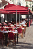 French restaurant South of France, sunny sidewalk cafe, vertical Royalty Free Stock Photo