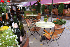 French restaurant with yellow flowers outdoor Royalty Free Stock Images