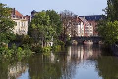 French river in Metz in France in the summer day with some classic houses. On the banks stock photography
