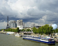 French Riverboat. An image representative of the riverboat travel on the Seine river and tourism in Paris, France Stock Images