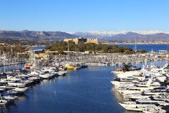 French Riviera, Antibes. View of port, yachts and fortress. French Riviera: winter evening in the resort of Antibes. View of port, yachts and fortress Royalty Free Stock Images