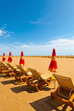 French Riviera. Beach Umbrella and Sun Bed in the Low Season of the French Riviera Royalty Free Stock Image