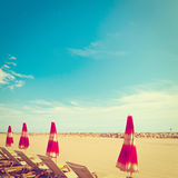 French Riviera. Beach Umbrella and Sun Bed in the Low Season of the French Riviera, Vintage Style Toned Picture Stock Image