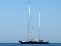 French Riviera - Black Sailboat Royalty Free Stock Image
