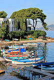 French Riviera - Boats near wharf. Local sailing boats near house on coast French Riviera Royalty Free Stock Image