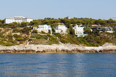 French Riviera coastline. Color DSLR stock image of luxury homes along the French Riviera coastline, as seen from the blue Mediterranean Sea.  Horizontal with Royalty Free Stock Photo
