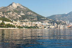 French Riviera coastline. Color DSLR stock image of luxury houses along the French Riviera coastline with a mountain in the background and the blue Mediterranean Royalty Free Stock Images