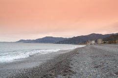 French Riviera at dawn. Bordighera beach and  French Riviera  at dawn,Monaco city is in the distance. Bordighera  is a town and commune in the Province of Royalty Free Stock Photo