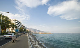 French riviera in Menton. Sidewalk and coastal road of French Riviera (Côte d'Azur) in Menton, France Stock Photos